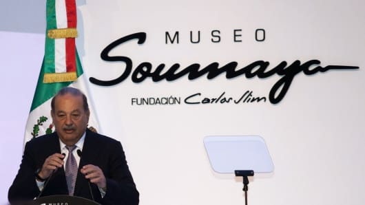Mexican billionaire Carlos Slim speaks during the media preview of his new Soumaya Museum in Mexico City, 2011