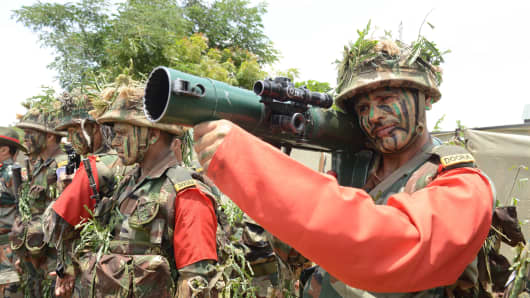 Indian army personnel perform Skirmish Order Fire Demo for the 68th Independence Day in Hyderabad, India.
