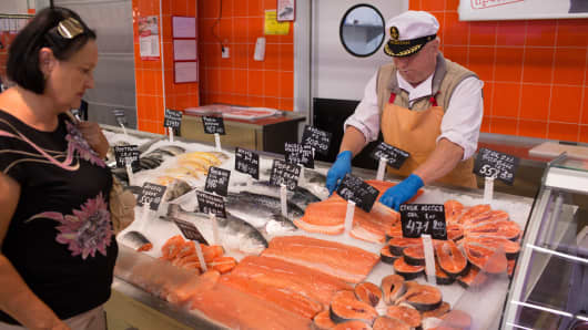 A fishmonger arranges a display of fresh imported Norwegian salmon inside an OAO Magnit hypermarket in Krasnodar, Russia, on Thursday, Aug. 7, 2014.