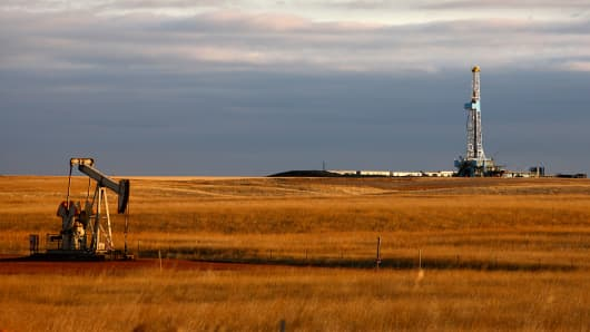 An oil-drilling rig stands on the Bakken formation in Watford City, N.D.