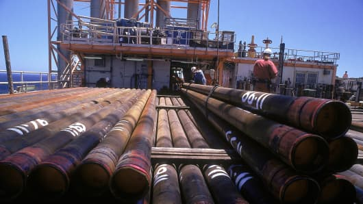 Workers working on an oil and gas processing deck.