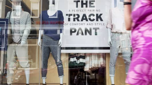 Mannequins wearing Gap Inc. track pants stand in a window display at a Gap store in Washington, D.C., U.S.