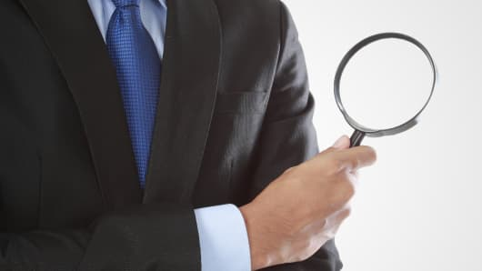 Businessman magnifying glass