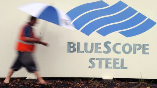 A worker leaves the BlueScope Steel refinery in Port Kembla near Sydney, Australia.