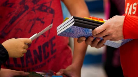 Customers shop for back to school supplies at a Target store.