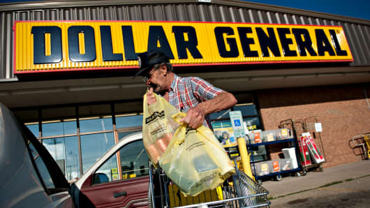 A shopper loads purchases into his vehicle outside a Dollar General Corp. store in Princeton, Illinois.