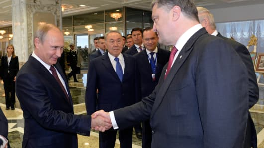 Russian President Vladimir Putin shakes hands with his Ukrainian counterpart Petro Poroshenko in Minsk on Aug. 26, 2014.