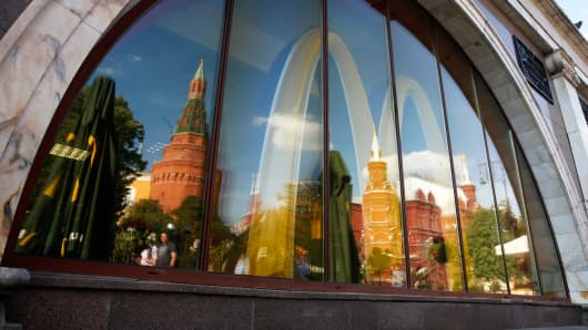 The Kremlin is reflected in a window of a closed McDonald's restaurant in Moscow, August 21, 2014.