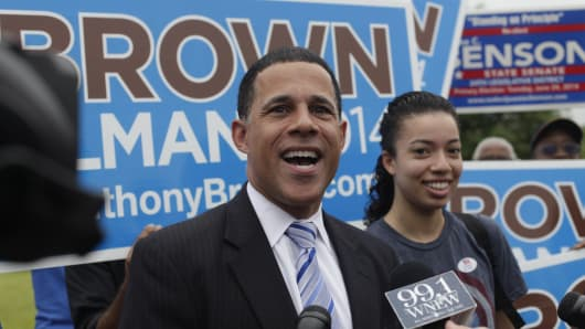 Lt. Governor of Maryland Anthony Brown accompanies his daughter Rebecca Brown to vote in Landover, Maryland, on June 12, 2014.