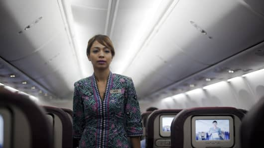 A Malaysia Airlines flight attendant prepares before take off.