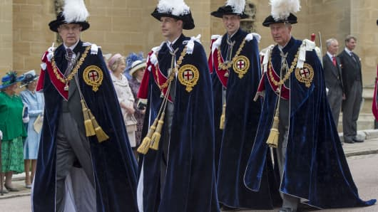 Britain's Prince Andrew, The Duke of York (L), Prince Edward, the Earl of Wessex, Prince Charles, The Prince of Wales (R) and Prince William, The Duke of Cambridge (2-R) take part in a procession to St George's Chapel