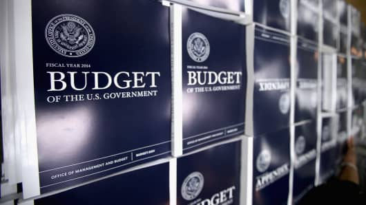 Copies of President Barack Obama's proposed budget plan for fiscal year 2014 are on display at the U.S. Government Printing Office in Washington.