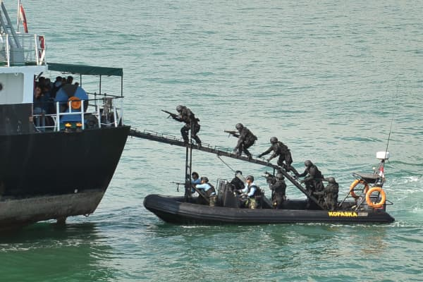 "In a demonstration to senior officers from the Indonesian and Singapore military and law enforcement agencies, Indonesian Navy Kopaska troops storm the ""hijacked"" vessel MT Promise off Batam island while it was cordoned by vessels from Republic of Singapore Navy, the Indonesian Navy, the Singapore Police Coast Guard and the Indonesian National Police."