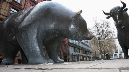 Bull and bear statues stand outside the Frankfurt Stock Exchange in Frankfurt, Germany.