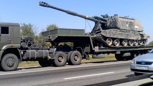A Russian military truck transports a self-propelled howitzer along a road near the town of Kamensk-Shakhtinsky, in the Rostov region of Russia.