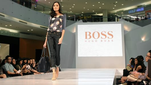 A model walks the runway at the Hugo Boss fashion show during Ciputra World Fashion Week in Surabaya, Indonesia.