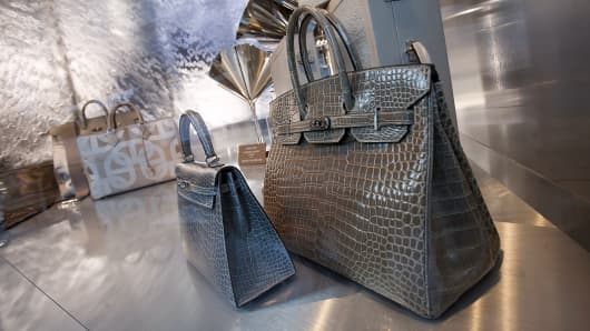 Hermes bags are on display in a store window in China.