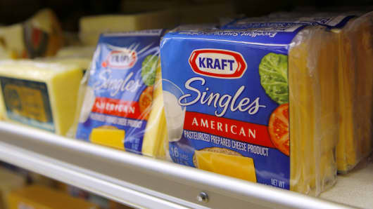 Packages of Kraft Singles American cheese product sit on the shelf of a market in San Francisco.