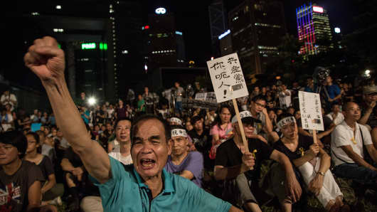 Protesters take part in the rally for the beginning of Occupy Central movement outside Central Government Offices in Central, Hong Kong.