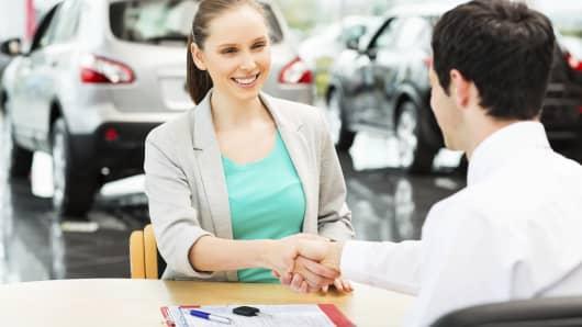 auto sales car dealership woman buying car