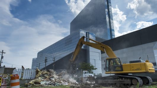 Revel Atlantic City stands behind a building being demolished in Atlantic City, New Jersey, U.S., on Thursday, July 17, 2014.