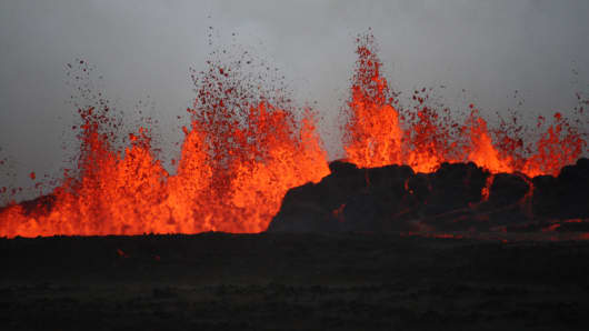 The lava flows on the the ground after the Bardabunga volcano erupted again on August 31, 2014.