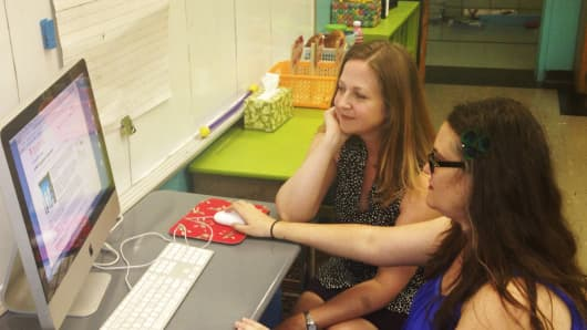Second grade teachers Jocelyn Benford (left) and Melissa Farran post a project request on DonorsChoose.org for their students.