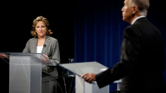 Sen. Kay Hagan, D-N.C., left, and Republican candidate for Senate Thom Tillis participate during a live televised debate at UNC-TV studios in Research Triangle Park, N.C., Wed., Sept. 3, 2014.