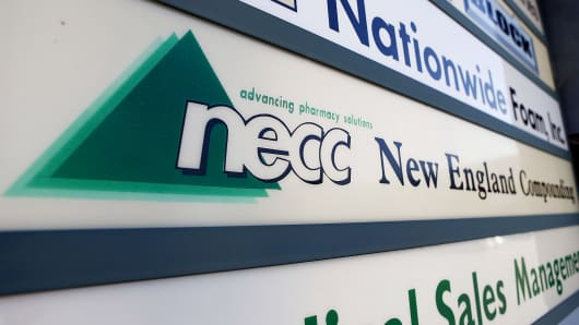 A sign for the New England Compounding Center is shown in Framingham, Mass.