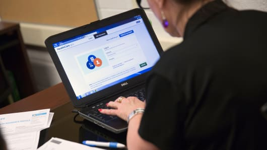 A marketplace guide works on the Healthcare.gov federal enrollment website.