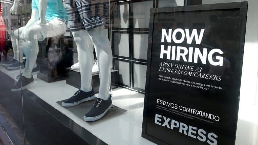 A now hiring sign is posted in the window of a clothing store in San Francisco.