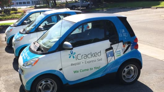 iCracked Smart cars outside the company's Redwood City, Calif., headquarters