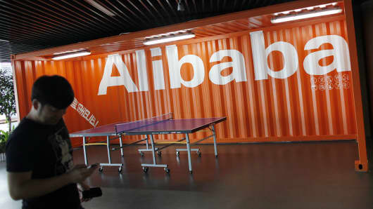 An employee walks past the Alibaba logo at the company's headquarters outside of Hangzhou, China.