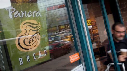 A customer exits a Panera Bread Co. location in New York, U.S.