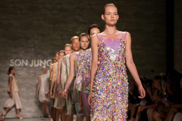 Models walk the runway during the Song Jung Wan fashion show at MBFW Spring 2015 in New York.