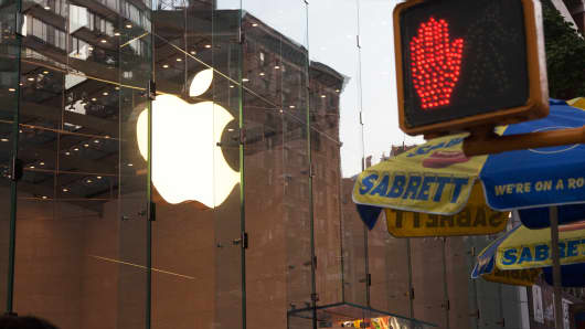 Apple logo and stop sign, New York.