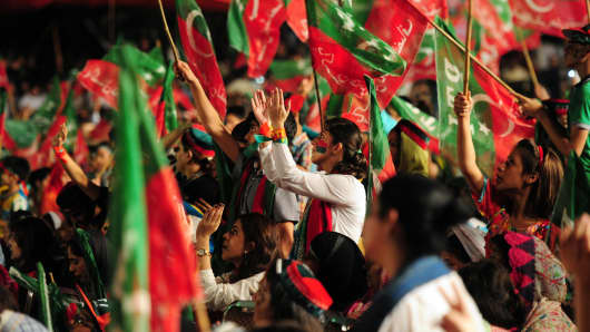 Supporters of Pakistani opposition politician Imran Khan wave Pakistan Tehreek Insaf (PTI) party flags during an anti-government protest in Islamabad on September 7, 2014.