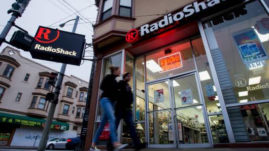 Pedestrians walk past a RadioShack store in San Francisco.