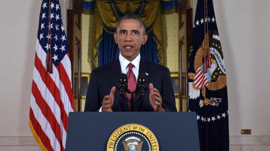 President Barack Obama delivers a prime time address from the Cross Hall of the White House on September 10, 2014 in Washington, DC. Vowing to target the Islamic State with air strikes 'wherever they exist', Obama pledged to lead a broad coalition to fight IS and work with 'partner forces' on the ground in Syria and Iraq.