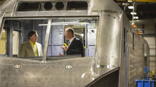 At the Siemens plant in Sacramento, Calif., Michael Cahill of Siemens and Myles Tobin of All Aboard Florida tour a locomotive under construction.