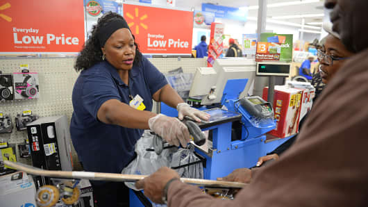 An employee rings up sales at a cash register of a Walmart store in Los Angeles.