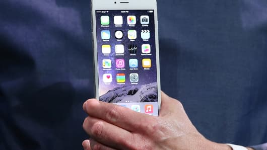 Apple CEO Tim Cook shows off the new iPhone 6 on Sept. 9, 2014 in Cupertino, Calif.