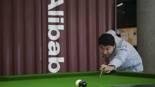 A man plays snooker in a hall inside Alibaba's headquarters in Hangzhou, Zhejiang province, April 23, 2014.