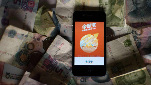 The logo of Yuebao, an investment product of Alibaba's online payments platform Alipay, displayed on a smartphone in Shanghai.