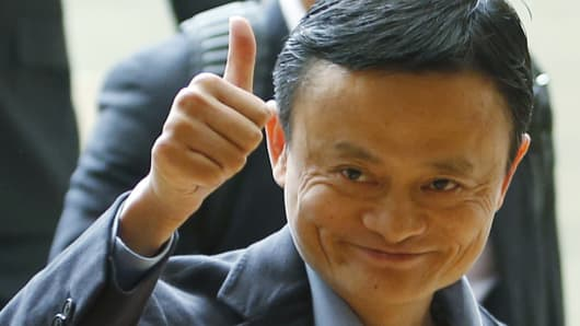 Alibaba founder Jack Ma gives a thumbs-up as he arrives to speak to investors at an initial public offering road show in Singapore Sept. 16, 2014.
