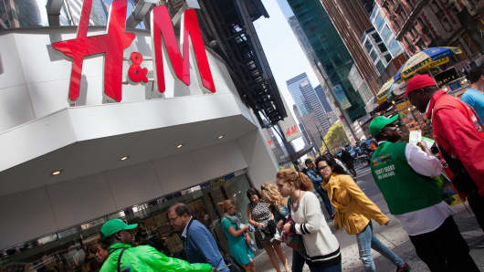 People outside an H&M store in New York.