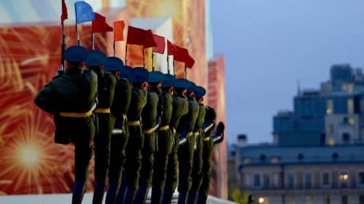 Russian soldiers march during a rehearsal of the Victory Day Parade at the Red Square in Moscow, Russia.