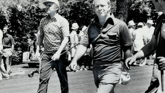 From left: Mark McCormack with Arnold Palmer.