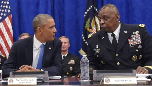President Barack Obama takes part in a briefing at US Central Command with General Lloyd Austin at MacDill Air Force Base in Tampa, on September 17, 2014.