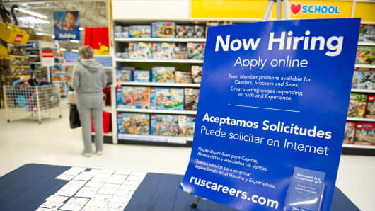 A Now Hiring sign to attract seasonal employees
